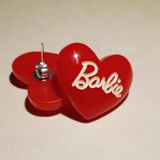 A set of kitsch red Barbie stud earrings which are a retro 1980s throwback