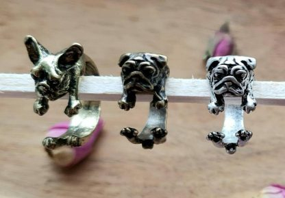 A set of cute adjutable pug / French bulldog rings handmade from epoxy resin by The Pea Hive
