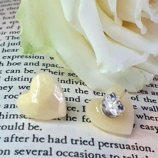 Heart shaped stud earrings handmade by The Pea Hive from champagne-coloured epoxy resin