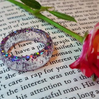 This cool electro looking sparkle ring has been handmade from epoxy resin by The Pea Hive