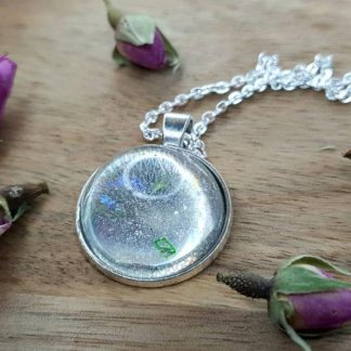 This clear multi orb pendant necklace resmebled a mini crystal ball and has been handmade from epoxy resin by The Pea Hive