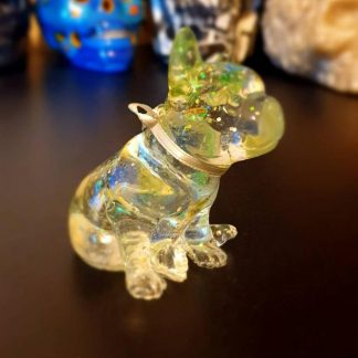A super cute French Bulldog statue with an electro glow which has been handmade from epoxy resin by The Pea Hive