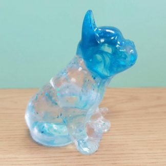 A French Bulldog statue with a blue swirl and glitter design handmade from epoxy resin by The Pea Hive