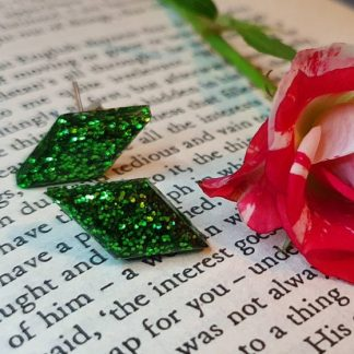 Diamond-shaped stud earrings handmade from green epoxy putty and set with glitter