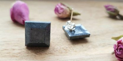 A set of gunmetal diamond stud earrings which have been handmade from epoxy resin by The Pea Hive