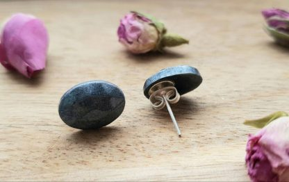 An elegant set of gunmetal oval stud earrings handmade from epoxy resin by The Pea Hive