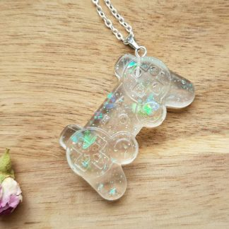 A miniature Playstation controller made from epoxy resin and used as a pendant on a cool necklace