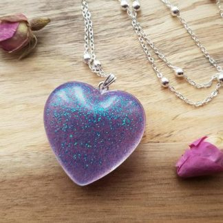 Purple heart pendant necklace made from epoxy resin and set with sparkle and glitter