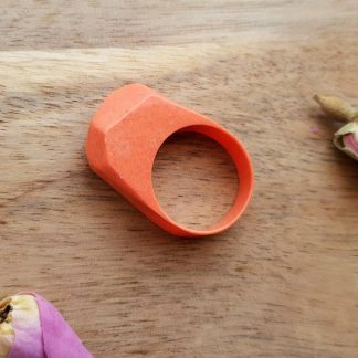 A retro geometric ring which ahs been handmade from casting resin by The Pea Hive