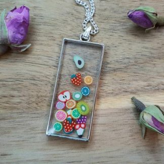 A pendant necklace handmade from epoxy resin with a cool Tutti Frutti design