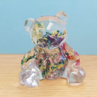 Geometric teddy bear statue handmade from epoxy resin by The Pea Hive and set with dried flowers