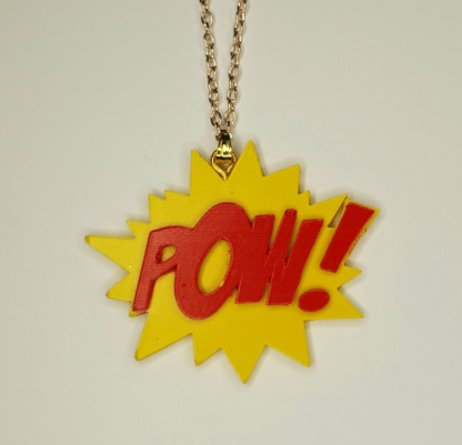 The POW Pendant Necklace is a statement piece of jewellery handmade from casting resin by The Pea Hive