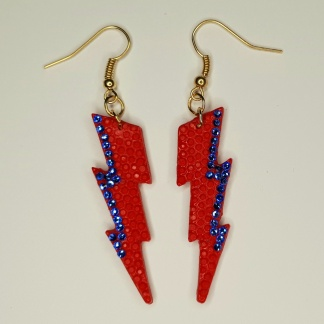 Red lightning bolt earrings handmade from casting resin as part of the POP! Collection from The Pea Hive