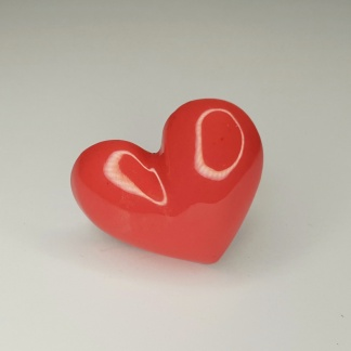 A red heart shaped 3D ring handmade from casting resin by The Pea Hive