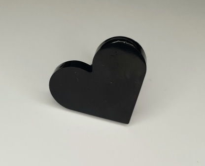 A black heart shaped ring which forms part of the POP! Collection from The Pea Hive