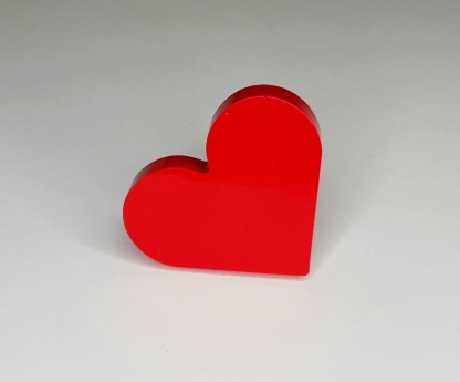 A Red Heart Shaped Ring handmade from casting resin by The Pea Hive