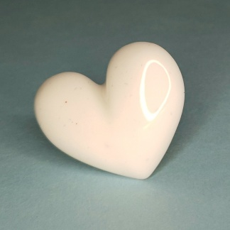 A white 3d heart shaped ring handmade from casting resin by The Pea Hive