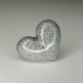 A holograhpic 3d heart ring handmade from casting resin by The Pea Hive