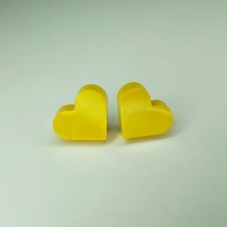 These Yellow Heart Shaped Stud Earrings will help the wearer win hearts
