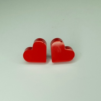 A cool set of red heart stud earrings handmade from casting resin by The Pea Hive