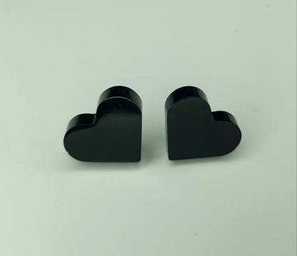 Steal hearts with these black heart shaped stud earrings handmade from casting resin by The Pea Hive